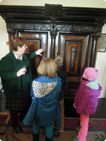 The kids are trying to figure out how this mysterious armoire opens