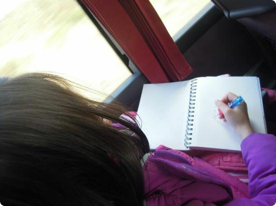 Darya draws the scenery in her journal on one of our bus trips